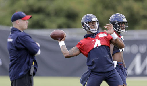 Houston Texans quarterback Deshaun Watson (4) throws a pass as coach Bill O'Brien, left, watches during the team's NFL football minicamp Wednesday, June 13, 2018, in Houston. (AP Photo/David J. Phillip)