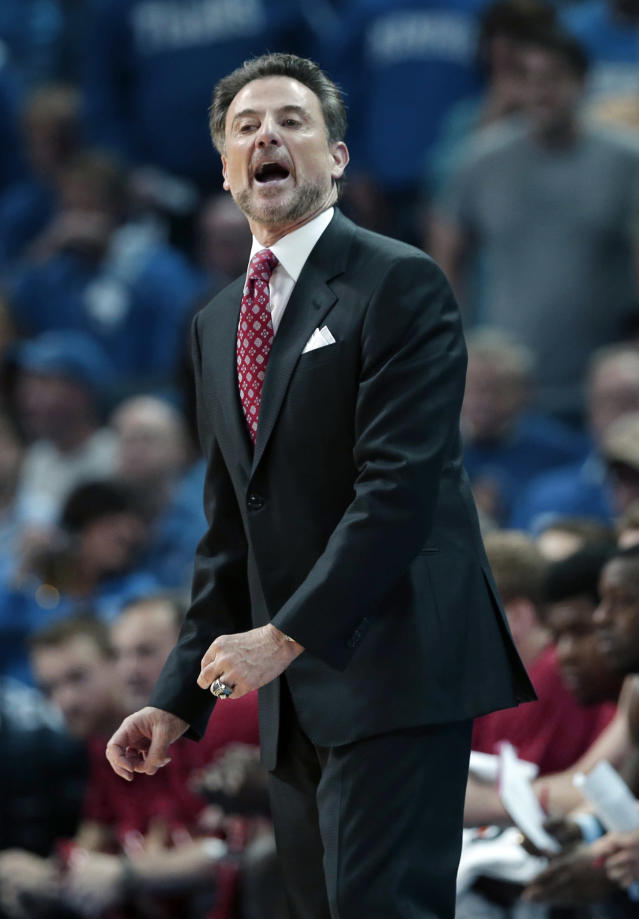 Louisville coach Rick Pitino shouts in the first half of an NCAA college basketball game against Memphis in Memphis, Tenn., Saturday, March 1, 2014. (AP Photo/Danny Johnston)