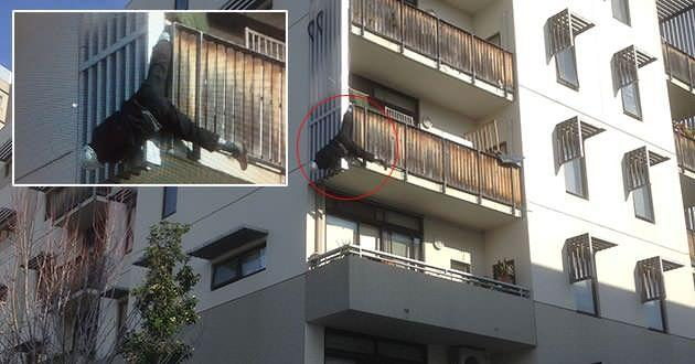 A wayward tradesman left dangling by his foot from a balcony. Photo: Supplied