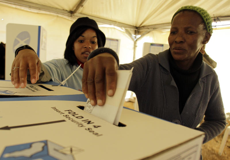 A voter cast her vote during the local municipal elections at the Zanspruit in Johannesburg, South Africa on Wednesday May 18, 2011. South Africans were voting across the country Wednesday in local elections that have national implications. The African National Congress, which governs at the national level, is expected to win in most municipalities, though the party has seen its popularity slip amid complaints it's riddled by corruption and failing to keep up with the demand for houses, schools, running water and other basics.(AP Photo/Themba Hadebe)