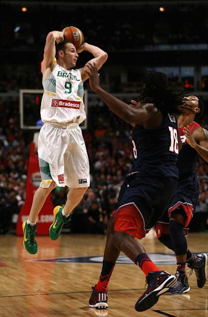 Marcelo Huertas of Brazil looks to pass in a 2014 exhibition against Team USA. (Getty)