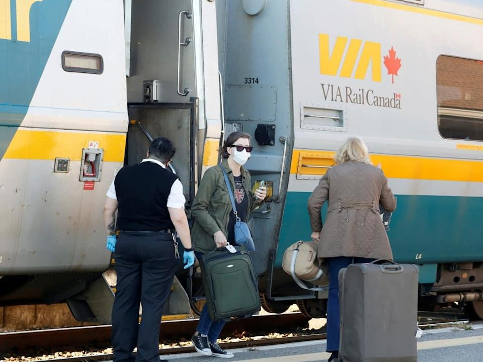 Via Rail passengers disembark a train in Ottawa Oct. 6, 2021. That same day, Prime Minister Justin Trudeau announced that passengers will require COVID-19 shots for air, ship and interprovincial train services. (Patrick Doyle/Reuters - image credit)