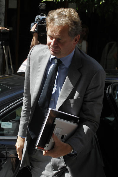 International Monetary Fund (IMF) mission chief Poul Thomsen arrives for a meeting between Greece's finance minister Yannis Stournaras and the debt inspectors from the European Central Bank, European Commission and International Monetary Fund, known as the troika at Greece's Finance ministry in Athens, Tuesday, Sept. 18, 2012. Debt-strapped Greece is negotiating a major new austerity package worth more than euro 11.5 billion ($15.1 billion) with its rescue lenders. The measures are a requirement for continued emergency loan payments. (AP Photo/Petros Giannakouris)