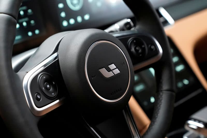 FILE PHOTO: The logo of Li Auto is seen on a steering wheel of a car at the company's showroom in Beijing