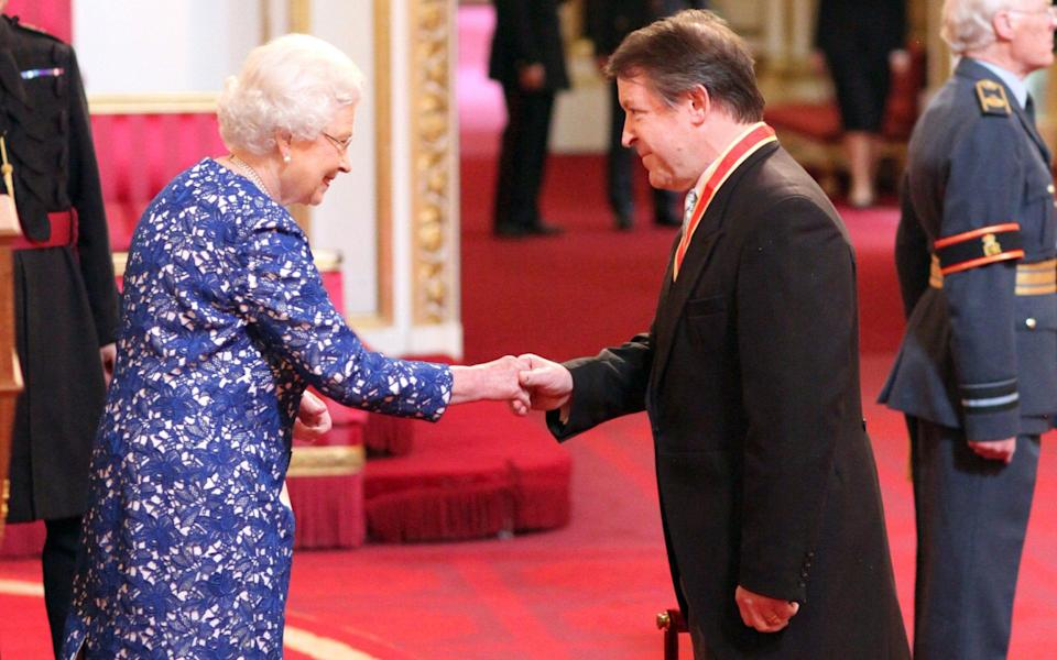 Roger Gifford is knighted by the Queen in 2014 - Anthony Devlin/PA Wire