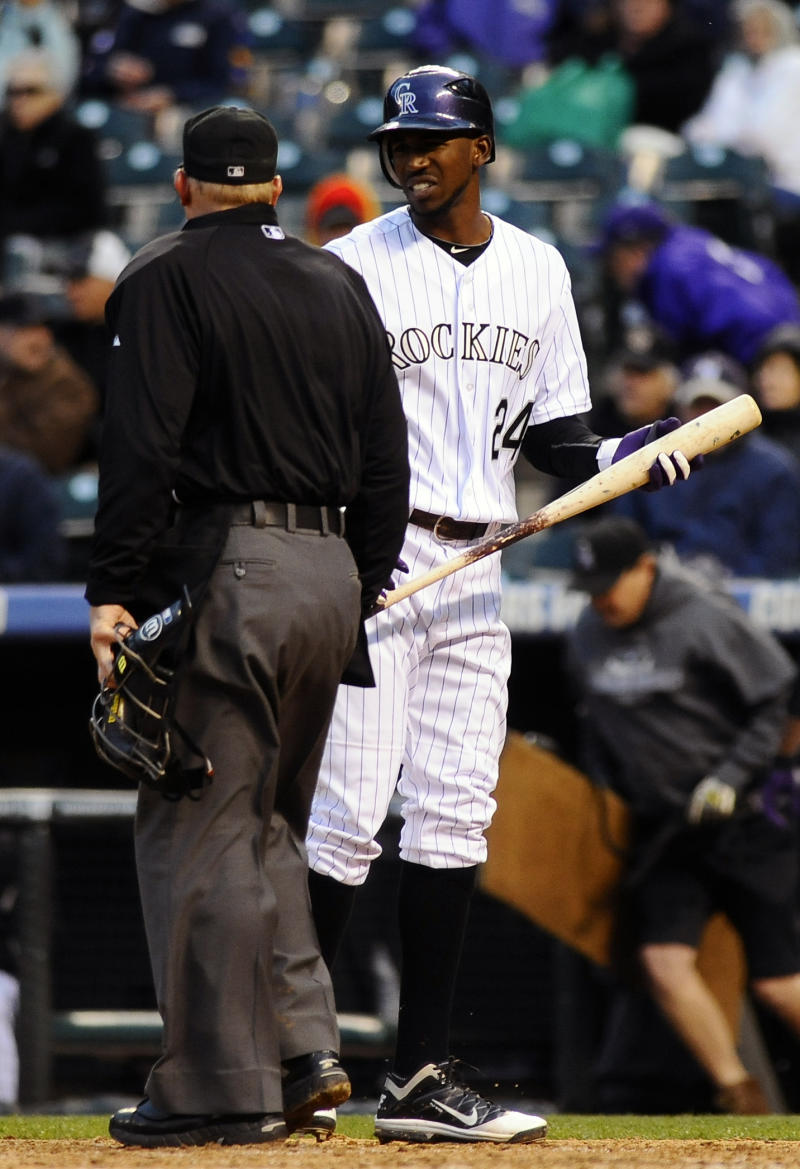 Colorado Rockies Dexter Fowler talks with home plate umpire Jeff Kellogg after striking out in the third inning of a baseball game against the Pittsburgh Pirates in Denver on Friday, April 29, 2011. The Pirates won 3-0. (AP Photo/Chris Schneider)