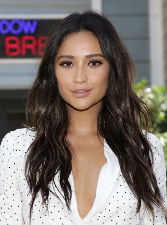"<p>The brunette bombshell attended the launch for ""Pretty Little Liars: Made Here"" with her locks styled loose and wavy and neutral makeup. (Photo: Jerritt Clark/Getty Images,) </p>"