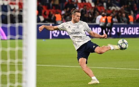 Real Madrid's Welsh forward Gareth Bale controls the ball during a warms up session prior to the UEFA Champions league Group A football match between Paris Saint-Germain and Real Madrid - Credit: AFP