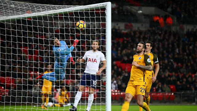 Serge Aurier's mishit cross proved pivotal as Tottenham edged past Brighton and Hove Albion 2-0 at Wembley in the Premier League.