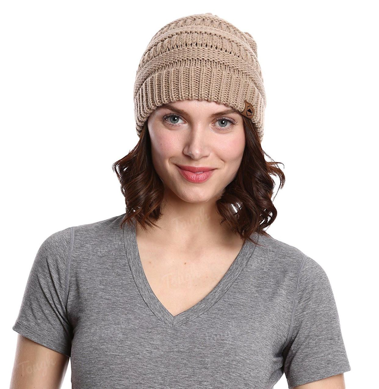I've had this <span>beanie</span> through my transitioning phase up until my full natural phase and it never disappoints. It actually stays on my head, fits over my curls, and for under $10 it's a true steal.