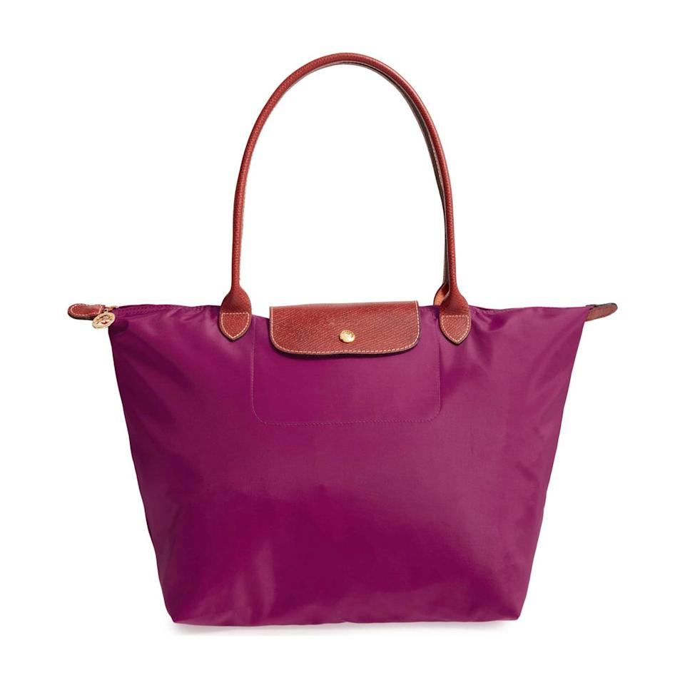 """<p>$145</p><p><a rel=""""nofollow"""" href=""""https://shop.nordstrom.com/s/longchamp-large-le-pliage-tote/3241956"""">SHOP NOW</a></p><p>This water-proof tote is exactly what she needs for traveling around the country visiting her grandchildren.</p>"""