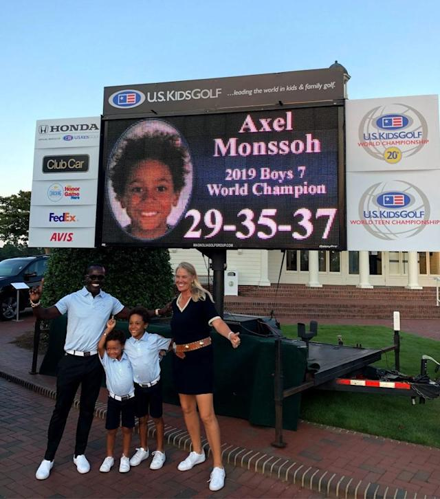 "<div class=""caption""> Axel (second from right) celebrates with his family after winning at the U.S. Kids world title <br> .<br> </div> <cite class=""credit"">Courtesy of the Monssoh Family</cite>"