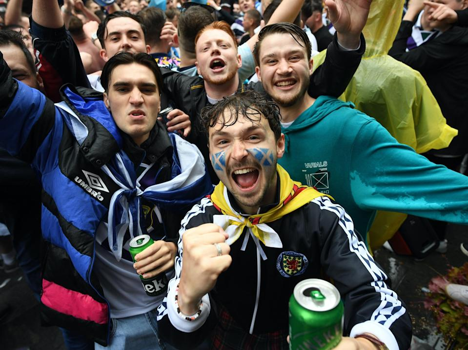 Scotland fans party in Leicester Square  (PA)