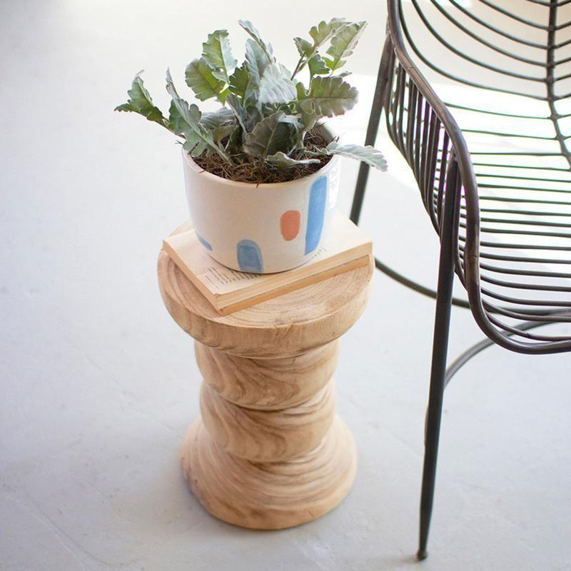 """<p>jungalow.com</p><p><strong>$99.00</strong></p><p><a href=""""https://www.jungalow.com/products/wooden-plant-stand"""" rel=""""nofollow noopener"""" target=""""_blank"""" data-ylk=""""slk:Shop Now"""" class=""""link rapid-noclick-resp"""">Shop Now</a></p><p>This hand-carved plant stand will make even the most basic of plants feel special. </p>"""