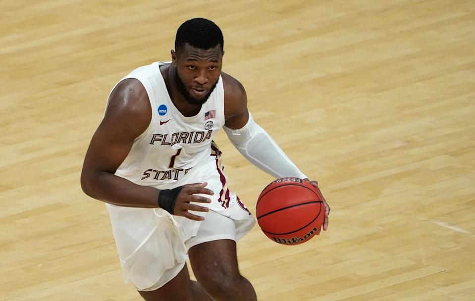 Mar 20, 2021; Indianapolis, Indiana, USA; Florida State Seminoles forward RaiQuan Gray (1) dribbles the ball against the UNCG Spartans during the second half in the first round of the 2021 NCAA Tournament at Bankers Life Fieldhouse.