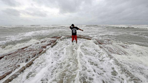 PHOTO: Luis Perez watches waves crash against a jetty in Galveston, Texas as Hurricane Harvey intensifies in the Gulf of Mexico, Aug. 25, 2017. (David J. Phillip/AP)