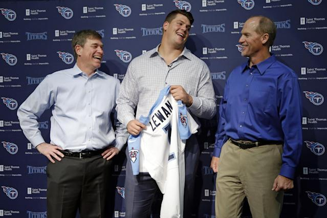 Tennessee Titans first round draft pick Taylor Lewan, an offensive lineman from Michigan, laughs with Titans general manager Ruston Webster, left, and head coach Ken Whisenhunt, right, at an NFL football news conference Friday, May 9, 2014, in Nashville, Tenn. Lewan was the 11th overall pick in the NFL draft on Thursday. (AP Photo/Mark Humphrey)