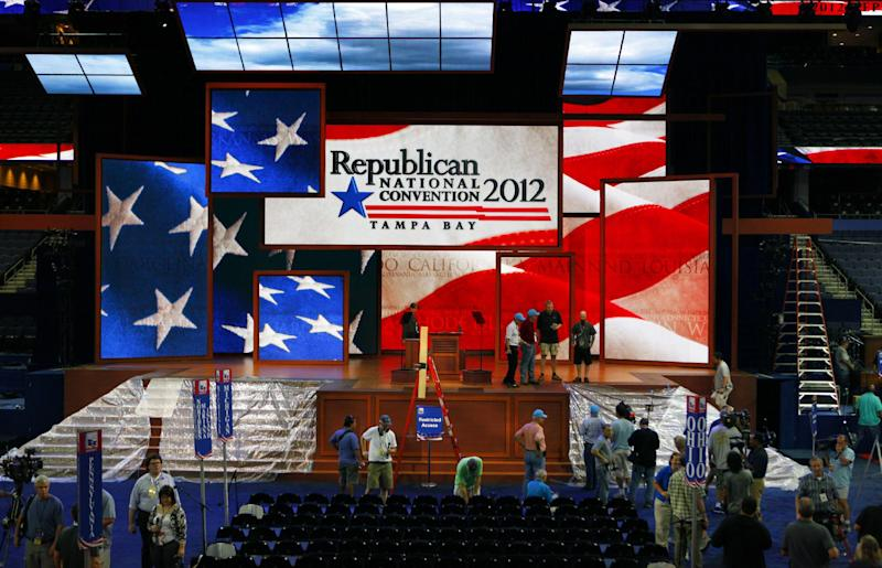Workers prepare the stage for the Republican National Convention inside the Tampa Bay Times Forum, Saturday, Aug. 25, 2012, in Tampa, Fla.  (AP Photo/J. Scott Applewhite)