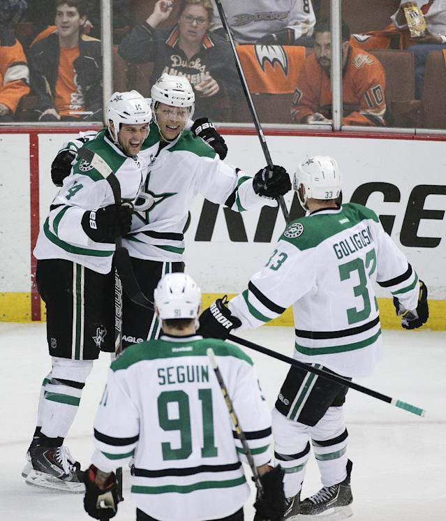 Dallas Stars' Alex Chiasson (12) celebrates his goal with Jamie Benn (14), Alex Goligoski (33) and Tyler Seguin (91) during the first period in Game 2 of the first-round NHL hockey Stanley Cup playoff series against the Anaheim Ducks on Friday, April 18, 2014, in Anaheim, Calif. (AP Photo/Jae C. Hong)