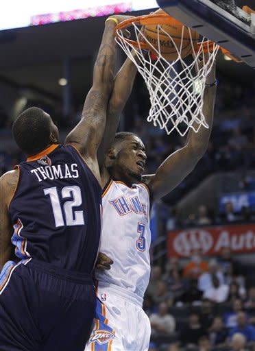 Oklahoma City Thunder forward Perry Jones (3) dunks in front of Charlotte Bobcats forward Tyrus Thomas (12) during the first quarter of a preseason NBA basketball game in Oklahoma City, Tuesday, Oct. 16, 2012. (AP Photo/Sue Ogrocki)