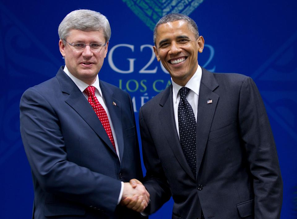 U.S. President Barack Obama shakes hands with Canada's Prime Minister Stephen Harper in bilateral meeting during the G20 Summit, Tuesday, June 19, 2012, in Los Cabos, Mexico.