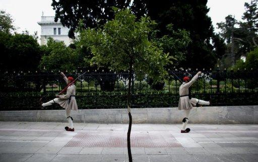 Greek presidential guards march in front of the Maximou presidential mansion in Athens