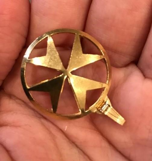 A gold Maltese cross on a gold chain was also taken. (Met Police)