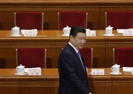 China's President Xi Jinping arrives before the opening session of the National People's Congress at the Great Hall of the People in Beijing