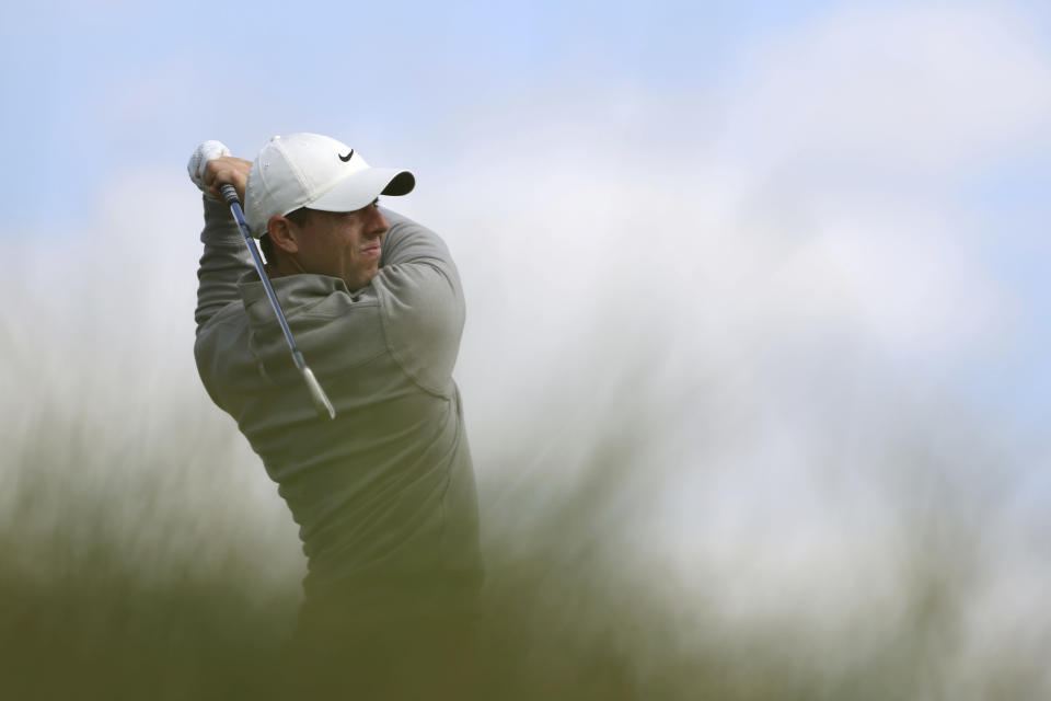 Northern Ireland's Rory McIlroy plays his tee shot on the 3rd hole during the second round of the British Open Golf Championship at Royal St George's golf course Sandwich, England, Friday, July 16, 2021. (AP Photo/Ian Walton)