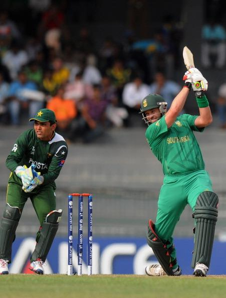 COLOMBO, SRI LANKA - SEPTEMBER 28:  Kamran Akmal of Pakistan looks on as Jacques Kallis of South Africa bats during the Super Eight match between Pakistan and South Africa at R. Premadasa Stadium on September 28, 2012 in Colombo, Sri Lanka.  (Photo by Pal Pillai/Getty Images)