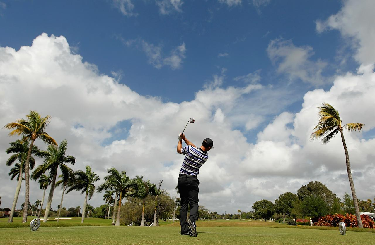 MIAMI, FL - MARCH 08:  Paul Casey of England watches his tee shot on the second hole during first round of the World Golf Championships-Cadillac Championship on the TPC Blue Monster at Doral Golf Resort And Spa on March 8, 2012 in Miami, Florida.  (Photo by Mike Ehrmann/Getty Images)
