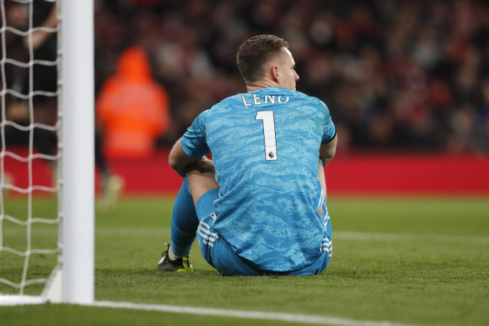 Arsenal's goalkeeper Bernd Leno sits on the pitch after failing to make a stop during the English Premier League soccer match between Arsenal and Brighton, at the Emirates Stadium in London, Thursday, Dec. 5, 2019. (AP Photo/Frank Augstein)