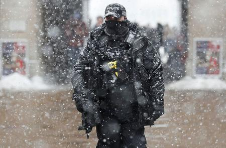 An armed police officer stands on duty at Horse Guards Parade in London, February 28, 2018. REUTERS/Peter Nicholls