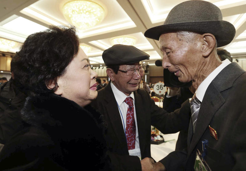 North Korean Nam Gung Ryuck, right, meets with South Korean daughter Nam Gung Bong-ja during the Separated Family Reunion Meeting at Diamond Mountain resort in North Korea, Sunday, Feb. 23, 2014. Elderly North and South Koreans separated for six decades are tearfully reuniting, grateful to embrace children, brothers, sisters and spouses they had thought they might never see again. (AP Photo/Yonhap, Lee Ji-eun) KOREA OUT