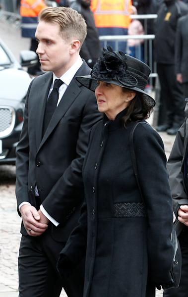 Jane Hawking and her son Timothy follow the coffin into Great St Marys Church, where the funeral of theoretical physicist Prof Stephen Hawking is being held, in Cambridge, Britain, March 31, 2018. REUTERS/Henry Nicholls