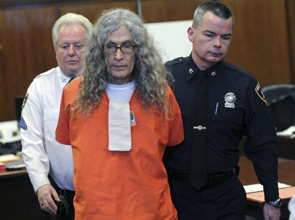 """FILE - In this Jan. 7, 2013, file photo, convicted serial killer Rodney James Alcala appears in court in New York. Alcala was sentenced to an additional 25 years to life in prison after pleading guilty to murdering two young women here in the 1970s. Alcala, a prolific serial torture-slayer dubbed """"The Dating Game Killer"""" has died while awaiting execution in California. Rodney James Alcala was 77. He died of natural causes at a hospital in San Joaquin Valley, Calif., prison officials said in a statement. Alcala was sentenced to death in 2010 for five slayings in California between 1977 and 1979, including that of a 12-year-old girl, though authorities estimate he may have killed up to 130 people across the country. (AP Photo/David Handschuh, Pool, File)"""