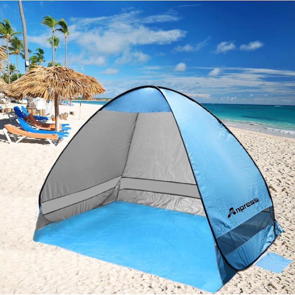 <p>Shield yourself from the sun with this <span>Anpress Outdoor Pop up Beach Tent </span> ($46).</p>