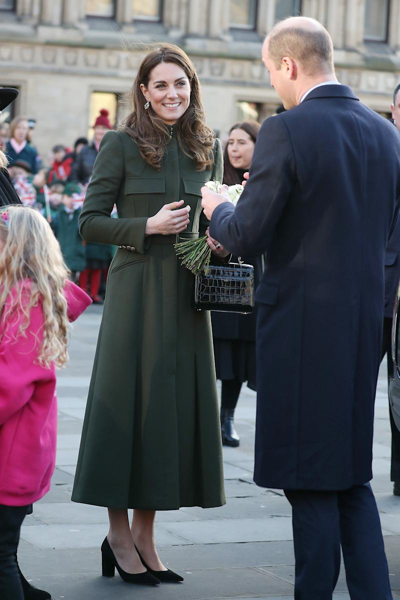 Prince William presents his wife Kate Middleton with a white rose outside Bradford's City Hall. Photo: Getty Images.