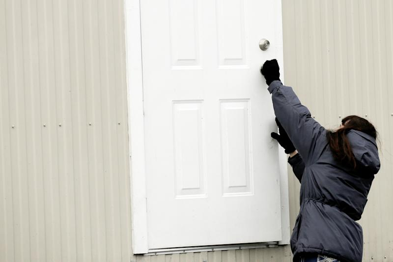 King County property agent Tami Elmer closes the door to one of 18 modular units that King County is using to house patients for treatment and isolation in relation to coronavirus is seen in Seattle, Washington, U.S. March 3, 2020. REUTERS/David Ryder