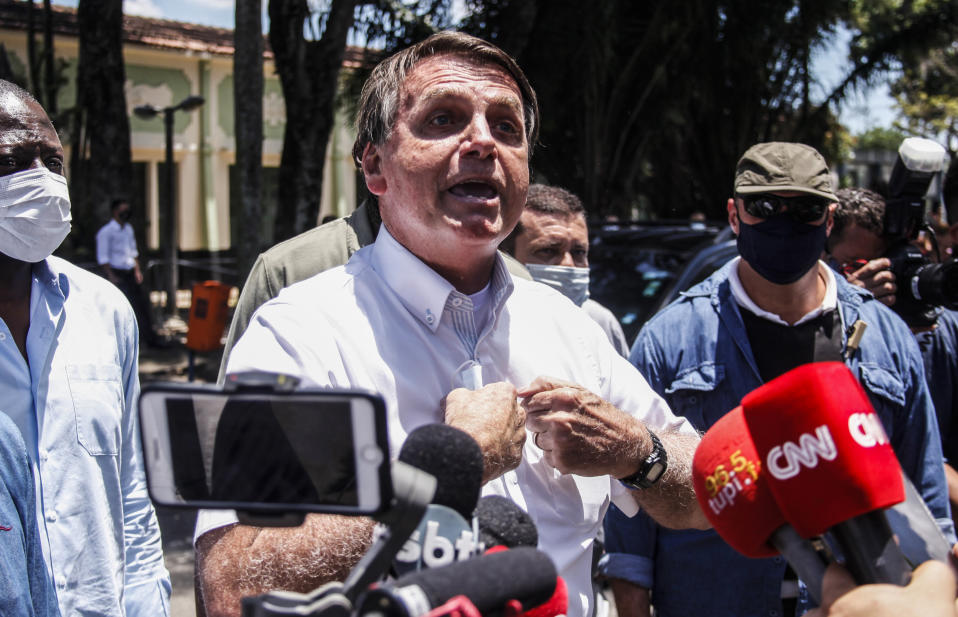 RIO DE JANEIRO, BRAZIL - NOVEMBER 29: President of Brazil Jair Bolsonaro talks to the press after voting during the municipal elections at Vila Militar on November 29, 2020 in Rio de Janeiro, Brazil. The city of Rio de Janeiro goes through a second round of municipal elections for Mayor in which Eduardo Paes of the Democratic Party (DEM) faces the current mayor of Rio de Janeiro and candidate for reelection, Marcelo Crivella of the Republicanos (Republicans) party. (Photo by Luis Alvarenga/Getty Images)