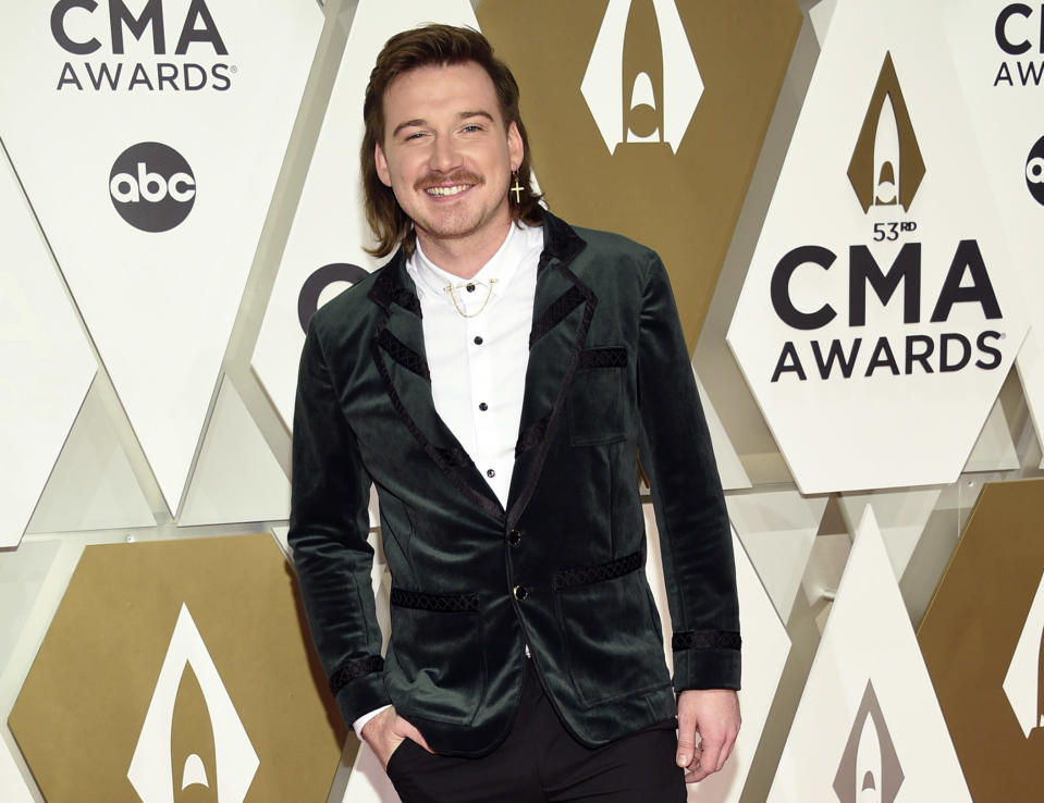 FILE - Morgan Wallen arrives at the 53rd annual CMA Awards on Nov. 13, 2019, in Nashville, Tenn. Wallen will still be eligible for multiple awards at this year's CMA Awards, but not the show's top prize. The disgraced country singer apologized after he was caught on camera using a racial slur in February. The Country Music Association's Board of Directors voted that Wallen won't be eligible for individual artist awards, such as entertainer of the year and male vocalist. (Photo by Evan Agostini/Invision/AP, File)