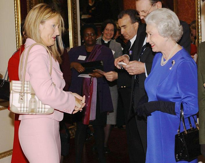 <p>The <em>Harry Potter</em> author opted for a light pink monochrome suit and paired it with a pale pink Burberry purse. How 2004 of her!</p>