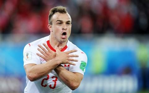 Xherdan Shaqiri of Switzerland celebrates scoring a goal during the 2018 FIFA World Cup Russia group E match between Serbia and Switzerland  - Credit: Getty images