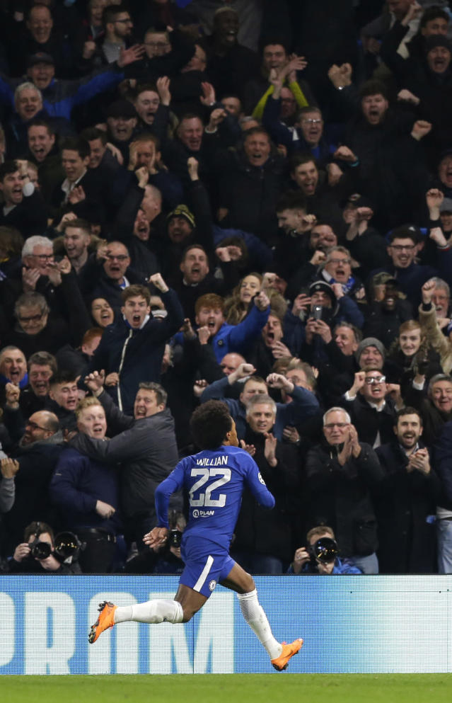 Chelsea's Willian celebrates scoring the opening goal during a Champions League round of sixteen first leg soccer match between FC Barcelona and Chelsea at Stamford Bridge stadium in London, Tuesday, Feb. 20, 2018. (AP Photo/Alastair Grant)