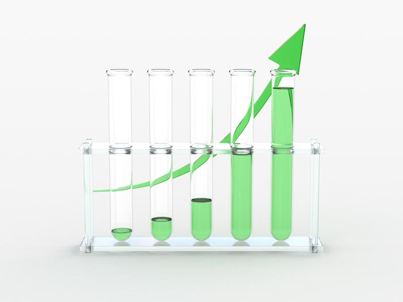 Five test tubes with increasingly higher levels of green fluid in each tube and a green line with an arrow at the end curving upward behind the test tubes