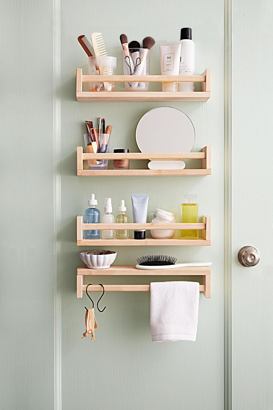 "<p>Carve out a space just for you by mounting spice racks on the wall. You can even invert one of these narrow shelves and use it as a towel-bar-slash-accessories-perch; just slip out the two keyhole-shaped brackets on the back, flip them, pop them back in, and hang it upside down. Behold: Your very own stress-free dressing station, with no one knocking to come in.</p> <p><strong><em>Shop Now:</em></strong><em> IKEA Bekväm Spice Racks, $5 each, <a href=""https://www.ikea.com/us/en/p/bekvaem-spice-rack-birch-40070185/"" rel=""nofollow noopener"" target=""_blank"" data-ylk=""slk:ikea.com"" class=""link rapid-noclick-resp"">ikea.com</a></em><em>.</em></p>"