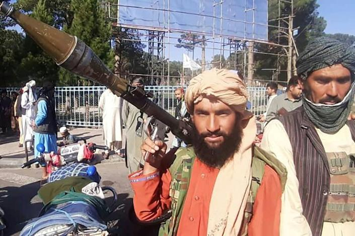 A Taliban fighter holds a rocket-propelled grenade in Herat