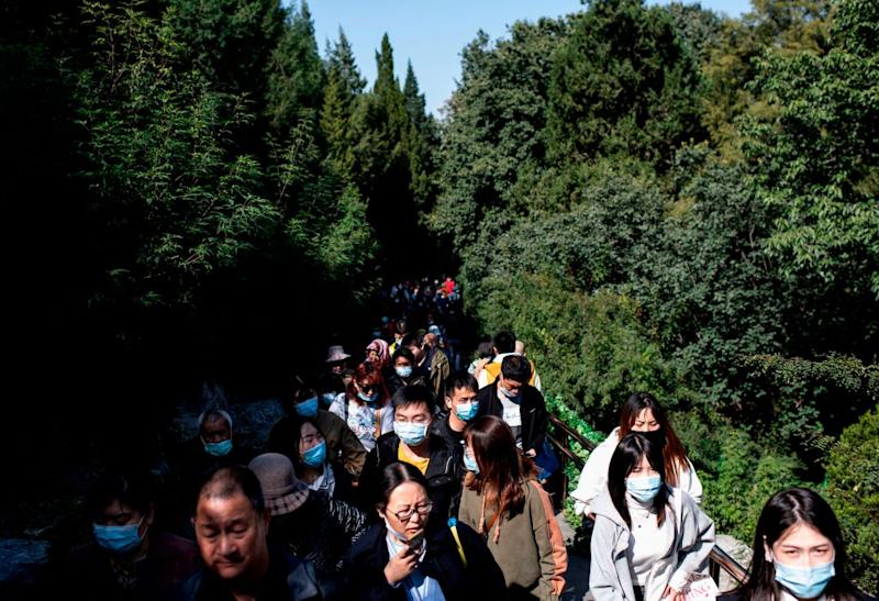 """Pictured are hundreds of people at Jingshan Park in Beijing during the country's national """"Golden Week"""" holiday."""