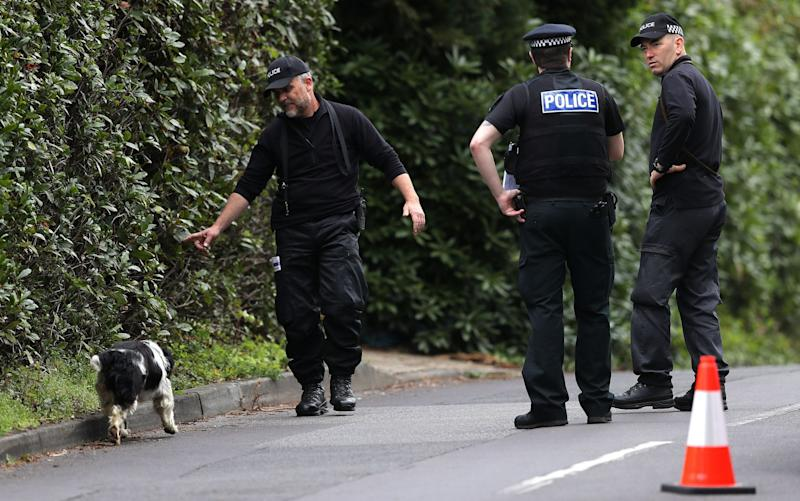 A police search dog is used in the hunt for clues - Credit: Andrew Matthews/PA