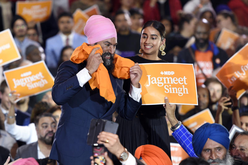 NDP leader Jagmeet Singh interacts with supporters as his wife Gurkiran Kaur Sidhu looks on during a rally in Brampton, Ontario, on Thursday, Oct. 17, 2019. (Nathan Denette/The Canadian Press via AP)